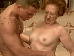 Mature lady Sabrina stands bending over the dining table having her pussy doggie fucked