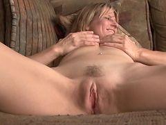 Shy Anilos blonde Berkley massages her moist pussy