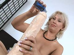 Fit milf peels off her lingerie and masturbates with a gigantic dildo