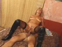 Blonde mature in stockings getting pounded in bed