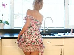 Fit soccer mom plays with her pussy in the kitchen