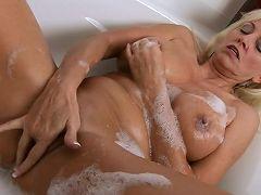 Blonde cougar Cala Craves masturbates in her bubble bath