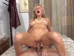 Horny 50 yr old riding cock
