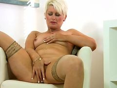 Short blonde haired milf fucks her pussy with her fingers