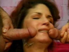 Fresckled dark-haired grandma gets caught between two cum-filled dicks