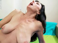 Fair skinned milf slams a purple dildo deep in her pussy