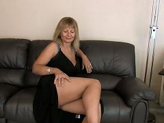 Cougar in high heels pulls her panties to the side and fingers her pussy