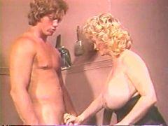 Mature slut plays with stiffy cock between huge boobs