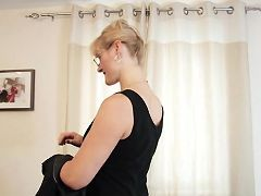 Cougar office assistant removes her clothes and masturbates
