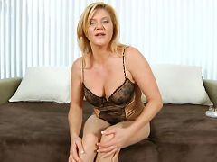 Ginger Lynn rips her pantyhose to make a hole for her glass dildo
