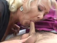 Blonde granny having some cock meat meal outdoors
