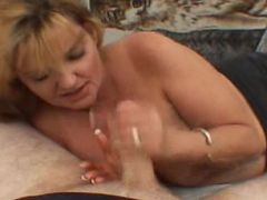 Chubby blonde momma sucking meaty fully erected dick topless