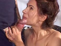 Horny brunette MILF gets to suck and harden two dicks at a time