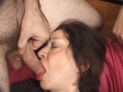 Horny granny sucking on a huge cock while jerking off another