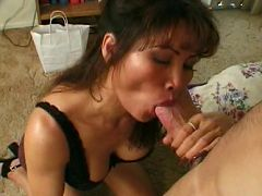 Brunette mature filling her warm mouth with dick
