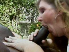 Naughty GILF enjoying a huge black meat stick