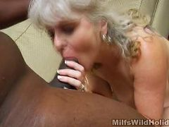 Hot milf Stacey fills her mouth with a huge black dick before getting fucked hard