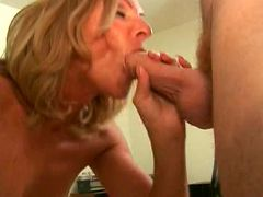 GILF babe lets a stud stuff her mouth with dick