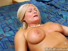 Juicy chested MILF Roxy enjoys having her shaved pussy pleased with a stiff and meaty dick