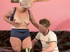 Blonde granny Susan lets a hot stud bend her over the sofa to fuck her pleasure hole