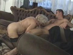 Granny whore in sexy sheer stockings having her tits massaged while cock riding