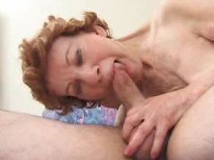 Short haired brunette granny deep throating a huge cock while massaging his balls