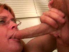 Curvy GILF gets her face covered with cock juice