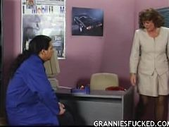 Slutty mature boss sucking cock in the office