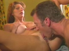 Big-breasted milf spreading wide to have her tight twat pumped.