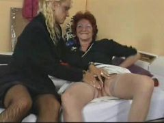 Nasty blonde whore ramming a huge dildo in horny granny's hungry hole