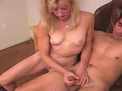 Horny blonde mama having her firm tits massaged by young gorgeous stud