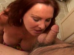 Mature woman Blue Iris sucks on a massive cock until it explodes cum in her mouth live