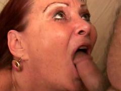 Granny Blue Iris sits on the floor sucking on a huge cock then enjoys a good cumshot