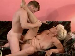 Mature blonde babe Susan layed on the sofa getting her pussy missionary fucked