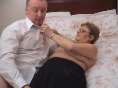Big tit granny Lynn sucks on a huge dick while her huge hooters got fondled