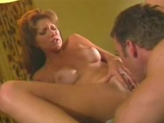 BIg-breasted redhead loving a titty-suck and a hard pussy-pounding.