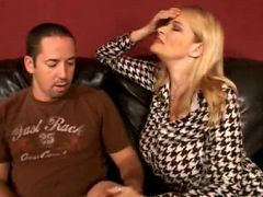Blonde milf Lynn Lemay lures a younger guy into probing her snatch by showing off her huge knockers
