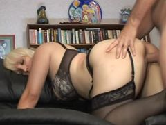 Blonde MILF Sophia Mounds wears a sexy lingerie while getting doggie fucked in a sofa