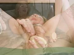 Leggy blonde cougar fucks herself with a giant dildo