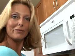 Golden bronze toned cougar Brenda James rides a thick dildo in the kitchen
